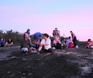 Walkers enjoy the views from Abyssinia Rock.