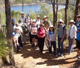 Walkers reach a viewing platform above the Mundaring Weir on their way to the pub.