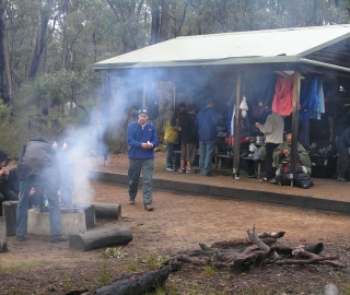 A full house. Enjoying the camp fire after the rain.